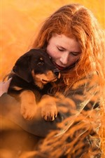 Preview iPhone wallpaper Red hair girl and dog, grass, nature
