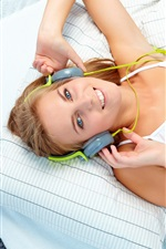 Preview iPhone wallpaper Smile girl listen music, headphones, bed