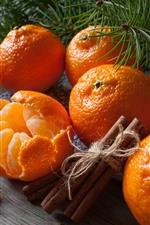Some tangerines, cinnamon, pine twigs