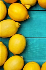 Preview iPhone wallpaper Some yellow lemons, blue wood board