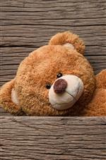 Preview iPhone wallpaper Teddy bear, wood board