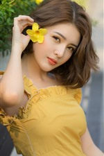 Preview iPhone wallpaper Yellow skirt Asian girl, flowers