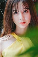 Preview iPhone wallpaper Asian girl, green leaves, bokeh