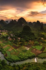 Beautiful Chinese village, mountains, green fields, river, top view