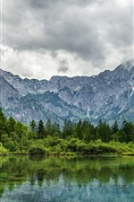 Beautiful nature landscape, mountains, trees, lake, water reflection