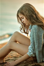 Preview iPhone wallpaper Blonde girl sit at beach, sands