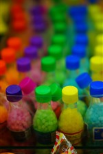 Colorful bottles, covers, low light