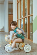Preview iPhone wallpaper Cute little girl play toy bike, child