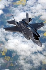 Preview iPhone wallpaper F-35B fighter flight in the sky, clouds