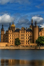 Preview iPhone wallpaper Germany, Schwerin, castle, river, trees, grass, dusk