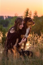 Preview iPhone wallpaper Girl and dog, grass, morning