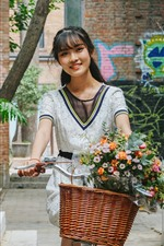 Preview iPhone wallpaper Happy Chinese girl riding bike, flowers