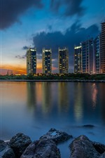 Preview iPhone wallpaper Jakarta, Indonesia, city, buildings, river, rocks, night