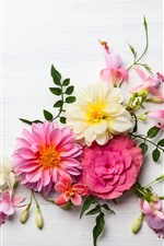 Pink and white flowers on the table