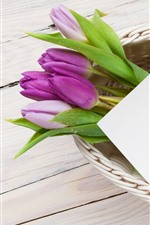 Preview iPhone wallpaper Purple tulips, colorful eggs, basket, Easter