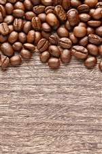 Preview iPhone wallpaper Roasted coffee beans, wood board
