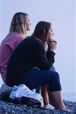 Preview iPhone wallpaper Two girls look at sea, coast, stones