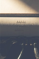 Preview iPhone wallpaper Typewriter, paper, light