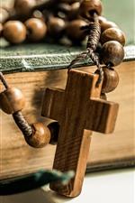 Beads, cross, book, still life