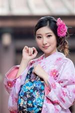 Beautiful Japanese girl, pink kimono, flower