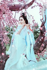 Beautiful retro style Chinese girl, white skirt, flute, sakura, spring