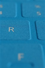 Blue keyboard surface close-up