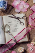Book, scissors, magnifier, camellia, still life