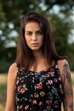 Brown hair girl, tattoo, blurry background