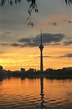 Preview iPhone wallpaper City, tower, lake, sunset