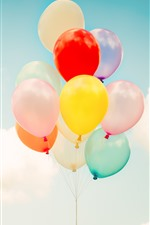 Colorful balloons, blue sky, clouds