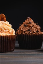 Preview iPhone wallpaper Delicious four kinds of cupcakes, cream