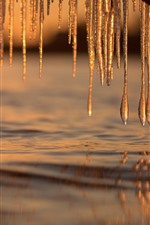 Preview iPhone wallpaper Icicles, water, sunset, winter