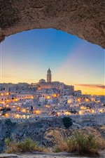 Preview iPhone wallpaper Italy, Matera, Basilicata, cave, grass, city, lights