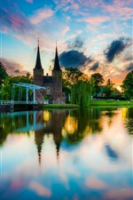 Preview iPhone wallpaper Netherlands, Delft, city, river, houses, trees, water reflection, sunset