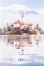 Preview iPhone wallpaper Slovenia, lake, island, church, mountains, snow, water reflection