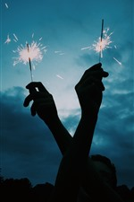Two hands, fireworks, sparks, night