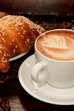 Coffee and croissant, coffee beans