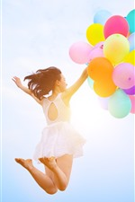 Preview iPhone wallpaper Girl jumping, colorful balloons, sky