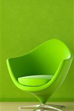 Green chair, lamp, wall
