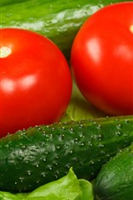Preview iPhone wallpaper Green cucumbers and red tomatoes, vegetable