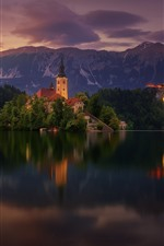 Preview iPhone wallpaper Lake Bled, church, Slovenia, trees, mountains, dusk