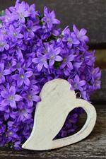 Many purple flowers, vase, bouquet