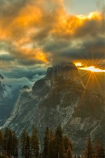 Preview iPhone wallpaper Mountains, clouds, sun rays, sunset, trees, grass