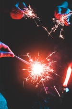 Preview iPhone wallpaper Night, fireworks, sparks, hands, holiday