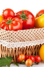 Preview iPhone wallpaper Red and yellow tomatoes, basket, white background