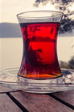 Preview iPhone wallpaper Red tea, glass cup, bench, river