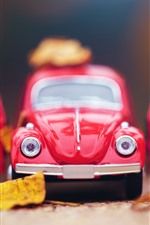 Preview iPhone wallpaper Red toy car front view, yellow leaves