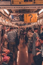 Tram compartment, people, Japan