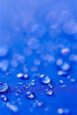 Preview iPhone wallpaper Water droplets, blue cloth surface