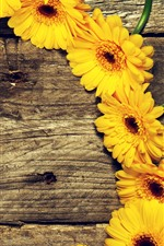 Preview iPhone wallpaper Yellow gerbera, wood board